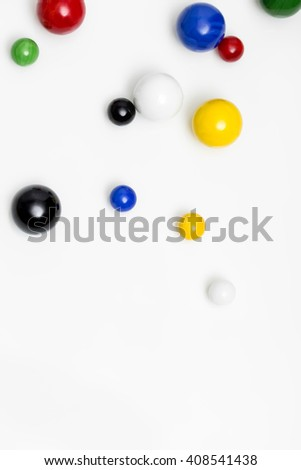 colorful marbles on white background with reflections, topview - stock photo