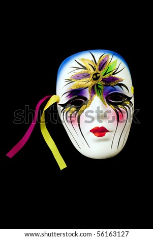 Colorful mardi gras mask on black background - stock photo