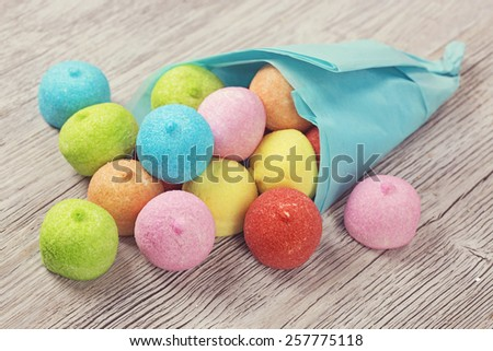 Colorful marshmallow on a wooden table - stock photo