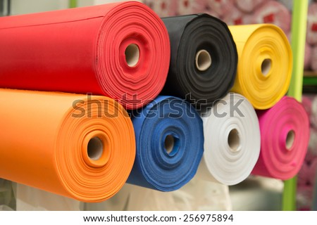 Colorful material fabric rolls -  texture samples - stock photo