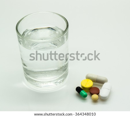 Colorful Medicine, Colorful Pills, Colorful capsule and glass of water on isolated