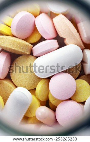 Colorful medicine pills in bottle,top view ,close up