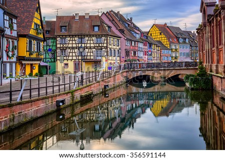 Colorful medieval half-timbered facades reflecting in water, Colmar, Alsace, France - stock photo