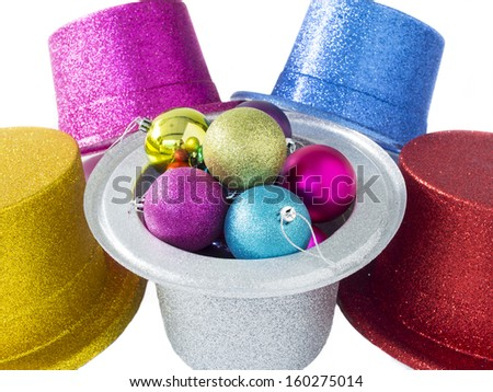 Colorful metallic party hats on white background - stock photo