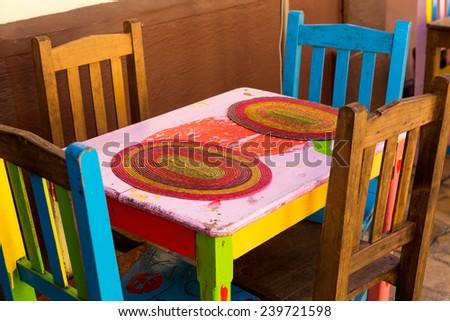 colorful Mexican patio diner set in San Cristobal de las Casas - stock photo