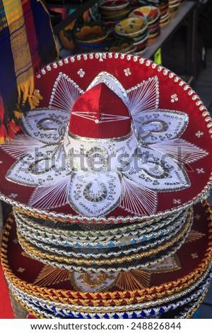 Colorful Mexican sombrero souvenirs for sale in Yucatan, Riviera Maya, Latin America. Mexico travel background.  - stock photo