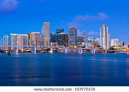 colorful miami waterfront skyline and harbor before dawn from macarthur causeway, high res capture, 2012 - stock photo