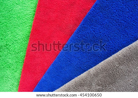 Colorful microfiber fabric for dust removal and cleaning wax on car or absorb water after car wash for dry. - stock photo