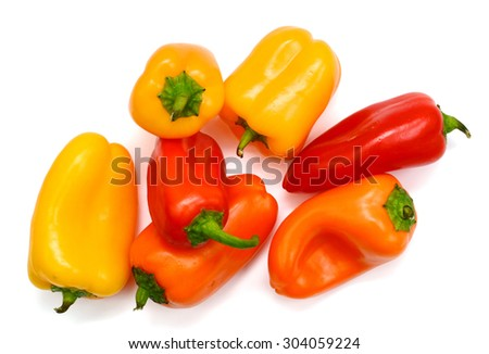 colorful mini peppers on white background