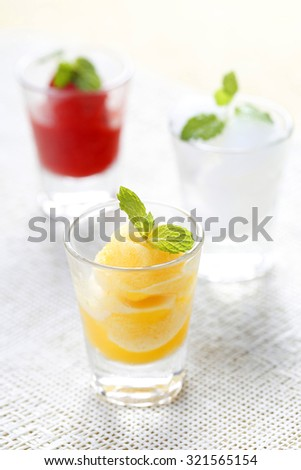 Colorful mix fruit sorbet in shot glass. - stock photo