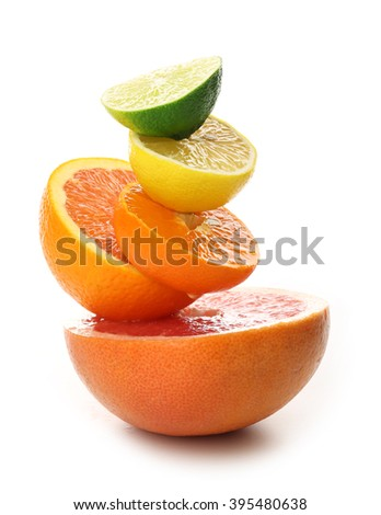 Colorful mixed citrus fruit stacked on top of each other, close up