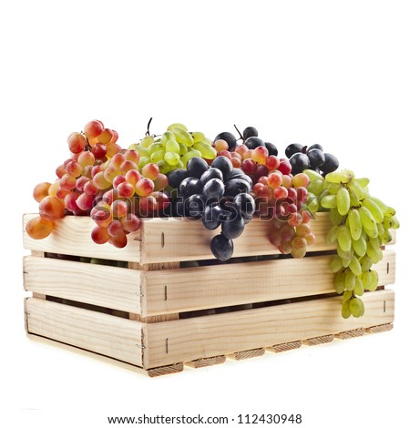 colorful  mixed grapes in a wooden crate box  isolated on a white background - stock photo