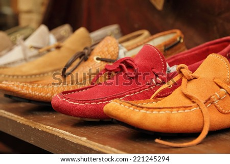 colorful moccasins style shoes on shelf by italian shoe maker, Italy - stock photo