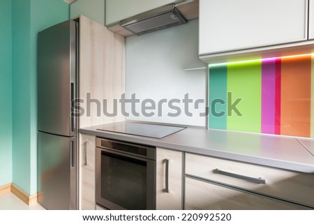 Colorful modern kitchen with decorative wall