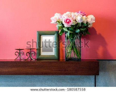 Colorful Modern Living room with vase of pink roses - stock photo
