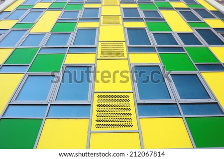 Colorful modern office building front as background