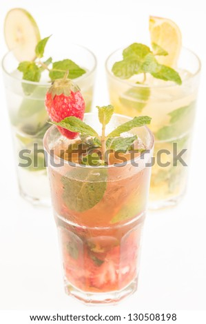 Colorful Mojito cocktails,  a Cuban cocktail made with cuban rum, lime, sugar, a splash of soda and flavoured with fresh fruit of your choice - stock photo