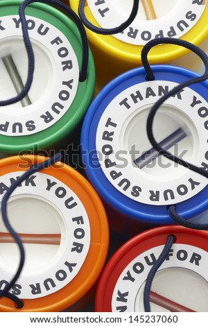 Colorful money boxes view from above - stock photo
