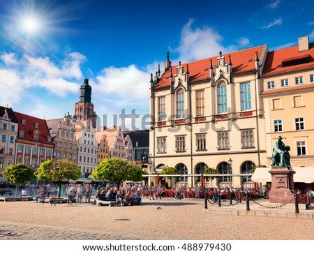Colorful morning scene on Wroclaw Market Square. Sunny cityscape in historical capital of Silesia, with? Statue of the Polish poet, playwright and comedy writer Aleksander Fredro, Poland, Europe.