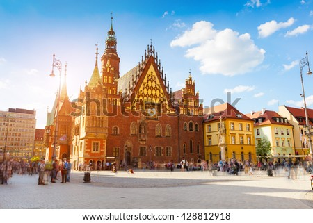 Colorful morning scene on Wroclaw Market Square with Town Hall. Sunny cityscape in historical capital of Silesia, Poland, Europe. Artistic style post processed photo. - stock photo