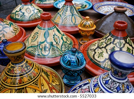 Colorful Moroccan pottery on display in a market - stock photo
