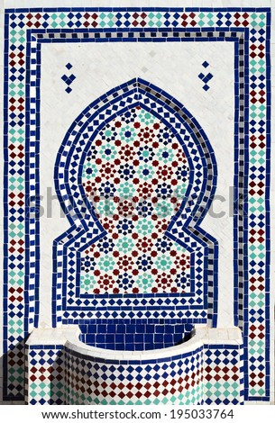 Colorful mosaic on typical moroccan fountain in medina of Meknes, Morocco. - stock photo