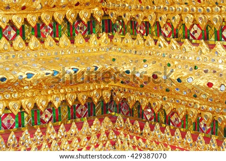 colorful mosaic pattern at Temple of the Emerald Buddha or Wat Phra Kaew at Bangkok, Thailand - stock photo