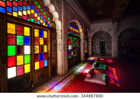 Colorful mosaic windows and doors in the emperor hall of , Meghrangarh fort in Jodhpur, Blue city, Rajasthan, India - stock photo