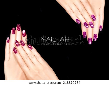 Colorful Nail Art. Trendy crackle nail polish in reds. Manicure and nail tattoo trend. Closeup of woman hands isolated on black background - stock photo