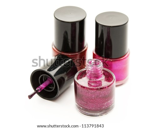 colorful nail polish in glass bubbles, white background