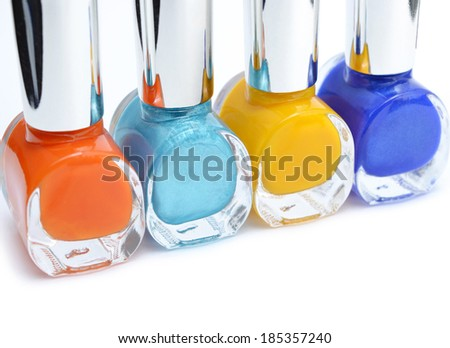 Colorful nail polish on white background with copy space. Macro with shallow dof. Selective focus on turquoise. - stock photo