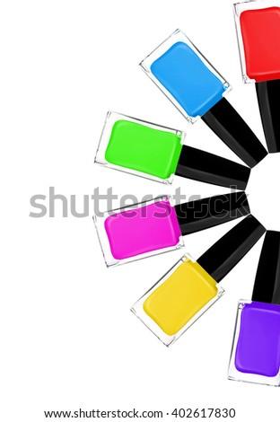 Colorful nail polishes, isolated on white - stock photo