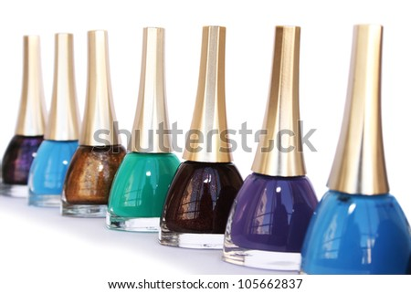 Colorful nail polishes isolated on white background.