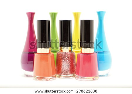colorful nails polish bottles isolated on white background