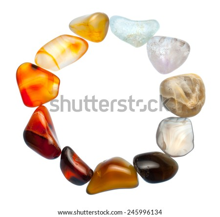 Colorful natural stones arranged in a circle, isolated on white. - stock photo