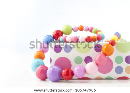 colorful necklace close up in box on white background
