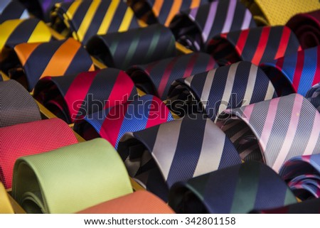 Colorful neckties coiled, fashion accessory  - stock photo