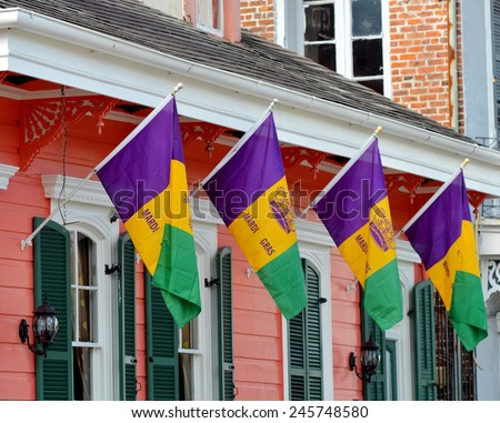 Colorful New Orleans French Quarter Architecture Decorated With Mardi Gras Flags For Carnival.