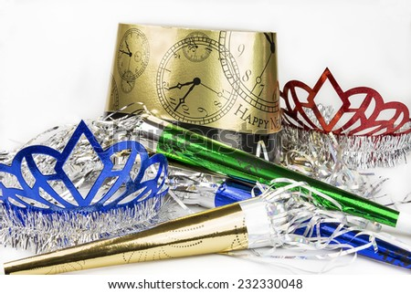 Colorful New Years eve party supplies on a white background.  Some room for copy space in top corners. - stock photo