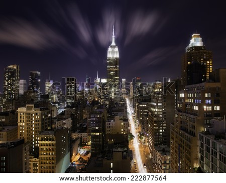 Colorful night over New York city, Manhattan island - stock photo