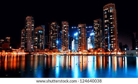 Colorful night view of city of Dubai with modern downtown buildings