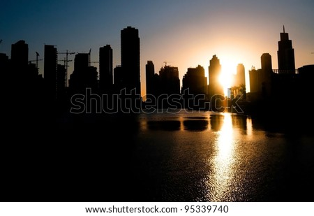 Colorful night view of city of Dubai with modern downtown buildings - stock photo