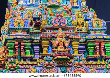 Colorful night view of indian gods sculpture at Sri Maha Mariamman Temple, also known as Maha Uma Devi temple, the public hindu temple in Silom, Bangkok, Thailand. It known as Wat Khaek Silom.