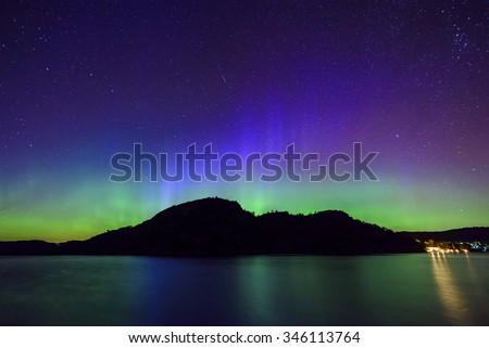 colorful northern lights (Aurora Borealis) at fjord landscape, Norway, Europe - stock photo