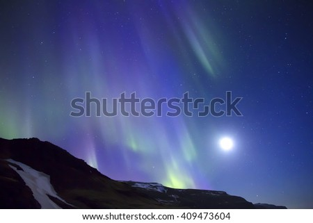 Colorful Northern Lights during full moon - stock photo