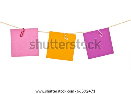 Colorful note papers drying on the rope