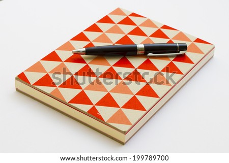 Colorful notebook and pen isolated on the white background. - stock photo