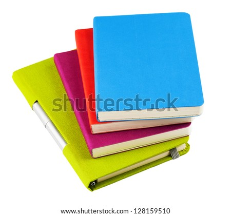 Colorful notebooks with open notebook and ballpoint pen isolated on white background - stock photo