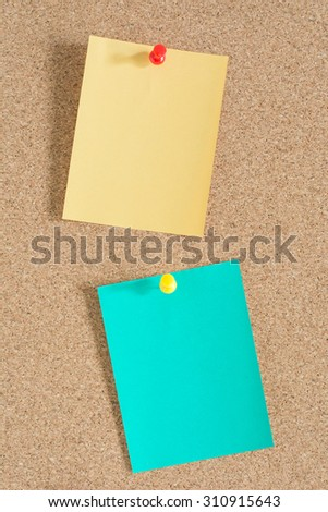 Colorful notes paper on cork board background