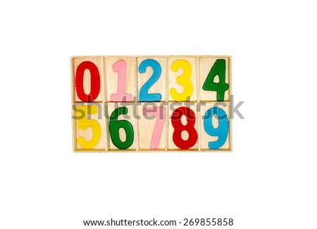 Colorful numeric inside wooden compartment on white background - stock photo